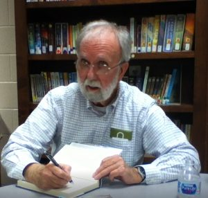 Mike signs books at the Moon Lake library in Mentone